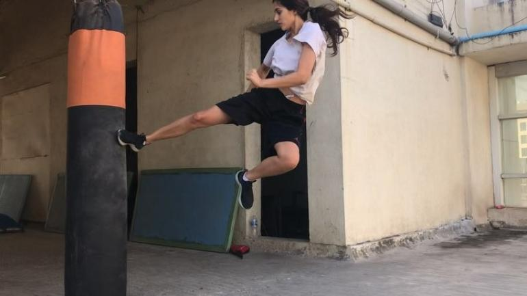 Photo of Disha Patani Surprises Tiger Shroff With Her Incredible Backflip